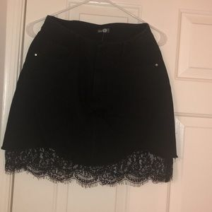 Black denim skirt with lace at the bottom